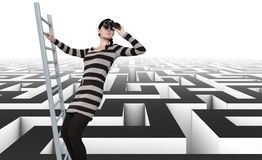 Labyrinth. Woman is looking for a way out of the labyrinth Royalty Free Stock Image
