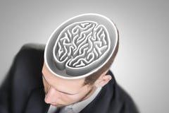 Labyrinthe de cerveau dans la tête de l'homme d'affaires Photo libre de droits