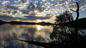 Lac au coucher du soleil Images stock