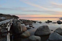 lac au-dessus de coucher du soleil Image stock