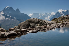 Lac Blanc. View over Lac Blanc to the Mont Blanc mountain range. Lac Blanc is situated in the Aiguille Rouge near Chamonix, France Royalty Free Stock Photo