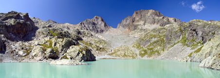 Lac Blanc of Chamonix. A pale blue lake between mountain rocks Royalty Free Stock Photography