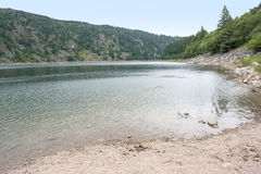 Lac Blanc. Lake named Lac Blanc in the Vosges mountains in Alsace, France Royalty Free Stock Photo