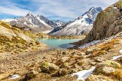 Lac Blanc And And Mountain Range - France. View Of Lac Blanc And Aiguille Verte, Aiguille du Chardonnet, Aiguille d Argentiere, Aiguille de l A Neuve And Glacier Royalty Free Stock Images