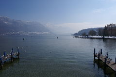Lac dAnnecy france. Lake Annecy in central france with snow covered mountains in the distance Royalty Free Stock Photography