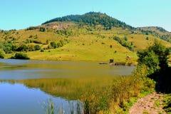 Lac dans Rosia Montana, montagnes d'Apuseni photo stock