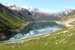 Artificial Grand-Maison Lake, the french Rhone-Alpes. Lac de Grand Maison is a lake in Isere, France at an elevation of 1698 m, created by the Grand`Maison Dam stock photos