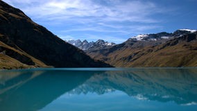 Lac de Moiry. Reflections in the Lac de Moiry (Graubunden, Switzerland Stock Photos