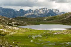Lac De Nino in Corsica with  mountains in the background Stock Image