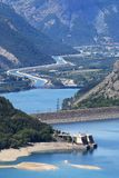 Dam in Lake Serre-Poncon and Durance river, french Hautes-Alpes. Lac de Serre-Poncon is a lake in southeast France and one of the largest artificial lakes in stock photo
