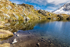 Lac des Cheserys And And Two Peaks - France Stock Images