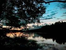 Lac Hameenlinna au coucher du soleil Images stock