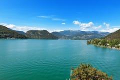 Lac lugano dans un jour d'été Photos stock