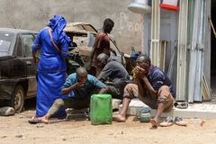 Unidentified Senegalese group of people gather near the car. LAC ROSE reg. , SENEGAL - APR 27, 2017: Unidentified Senegalese group of people gather near the car royalty free stock photos