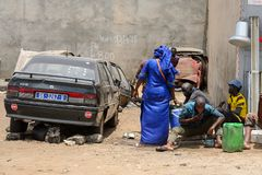 Unidentified Senegalese group of people gather near the car. LAC ROSE reg. , SENEGAL - APR 27, 2017: Unidentified Senegalese group of people gather near the car royalty free stock photography