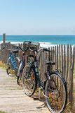 Lacanau, Atlantic Ocean, France, access to the beach. Bicycles left by tourists near the central beach of Lacanau, a French seaside resort on the Atlantic Coast Stock Photo