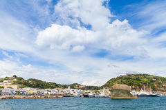 Lacco Ameno under blue sky, Ischia island, Italy. Coastal landscape of Lacco Ameno under cloudy blue sky, Ischia island, Italy Royalty Free Stock Photography
