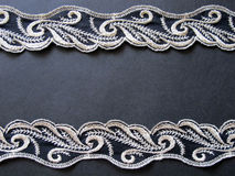 Lace. White lace on black background Stock Image