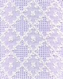 Lace. Handmade white lace with violet background. This image is very fine also horizontally rotated stock images