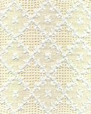 Lace. Handmade white lace with yellow background royalty free stock photo