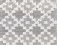 Lace. Handmade white lace with wood background stock photography