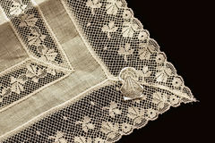 Lace. Closeup of detail of Irish linen handkerchief on black velvet Royalty Free Stock Images