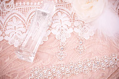 Lace with accessories, silver jewelry and perfume Stock Photo