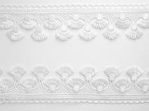 Lace background. White lace on white background Royalty Free Stock Photos
