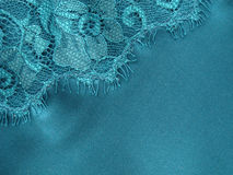 Lace background. Lace and silk turquoise background Stock Photo