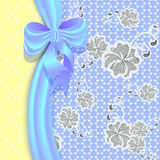 Lace background with a satin ribbon and bow. Royalty Free Stock Photo
