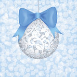 Lace bauble and blue bow Royalty Free Stock Image