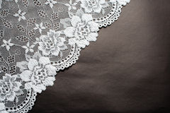 Lace on black. White lace on black paper background Royalty Free Stock Photo