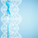Lace on blue background Royalty Free Stock Photo
