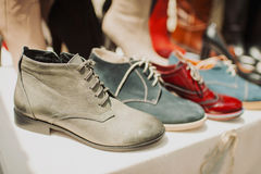 Lace boots in different colors Royalty Free Stock Photos