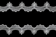 Lace Border. White scalloped lace over black background. A lovely delicate border stock photography