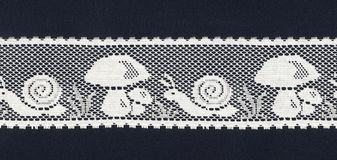 Lace border background. A lace border showing mushrooms and snails stock photo