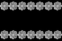 Lace border on black. Background royalty free stock image
