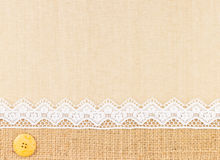 Lace border. Over Canvas texture design for background royalty free stock photography