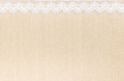 Lace border. Over Fabric textile texture design for background royalty free stock image
