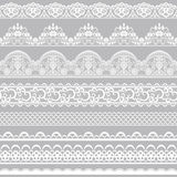 Lace borders. Set of white lace borders isolated on gray background Stock Image