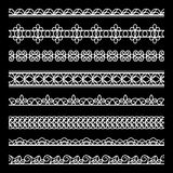 Lace borders set. Set of white lace borders, ornamental dividers, lacy ribbons on black Stock Photography