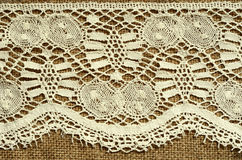 Lace on canvas Stock Image