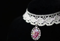 Lace choker with a pendant made of epoxy resin and rose petals Royalty Free Stock Photography