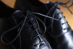 Lace close-up detail of a pair of classic black leather shoes Royalty Free Stock Photo
