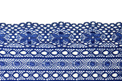 Lace closeup. Closeup of blue lace on white background stock photos