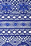 Lace closeup. Closeup of blue lace on white background Stock Image
