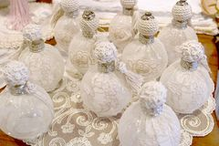 Lace covered perfume bottles for sale - Burano - Venice Royalty Free Stock Images