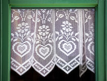 Lace curtain with a hearts. Symbol of love Royalty Free Stock Images