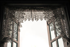 Lace curtain. On wooden window Stock Images