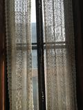 Lace curtains. Pretty delicate lace curtains Royalty Free Stock Photo